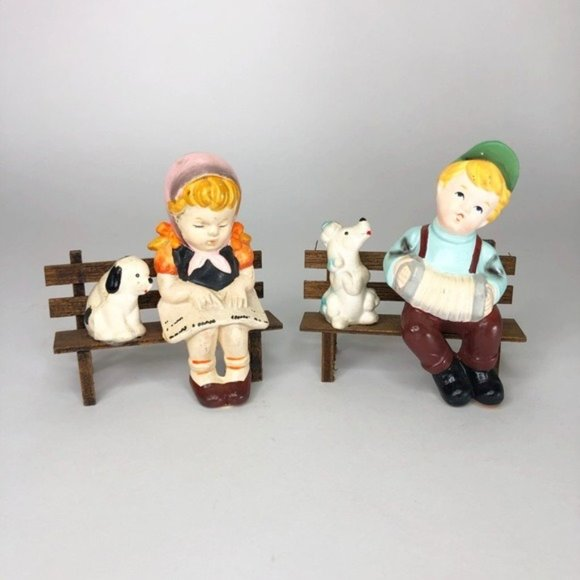 Darling little boy and girl on benches with pets